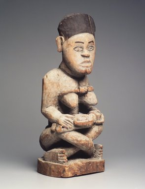 Kongo (Yombe subgroup). Mother and Child Figure, late 19th or early 20th century. Wood, pigment, 21 1/2 x 8 x 8 1/2in. (54.6 x 20.3 x 21.6cm). Brooklyn Museum, Museum Expedition 1922, Robert B. Woodward Memorial Fund, 22.1139. Creative Commons-BY