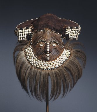 Kuba (Bushoong subgroup). Mwaash aMbooy Mask, late 19th or early 20th century. Hide, paint, plant fibers, textile, shell, glass, wood, hair, feathers, 22 x 20 x 18 in. (55.9 x 50.8 x 45.7 cm). Brooklyn Museum, Museum Expedition 1922, Robert B. Woodward Memorial Fund, 22.1582. Creative Commons-BY