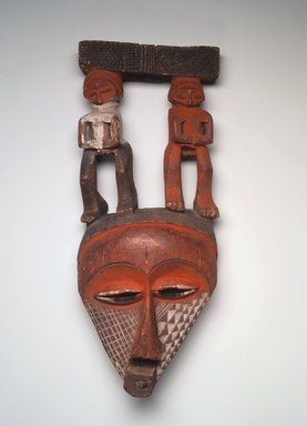 Pende (Eastern). Triangular Mask Surmounted by Male and Female Figures, 19th century. Wood, pigment, pyro, 15 3/4 x 6 1/2 x 3 1/4in. (40 x 16.5 x 8.3cm). Brooklyn Museum, Museum Expedition 1922, Robert B. Woodward Memorial Fund, 22.1690. Creative Commons-BY
