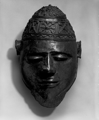 Ali Amonikoyi (Nigerian, 1880-1920). Mask, ca. 1910. Copper alloy, 10 1/2 x 7 1/4 x 5 1/2 in.  (26.7 x 18.4 x 14.0 cm). Brooklyn Museum, Museum Expedition 1922, Robert B. Woodward Memorial Fund, 22.1692. Creative Commons-BY