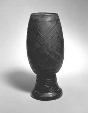 Kuba. Palm Wine Cup (Mbwoongntey), 19th century. Wood, copper alloy, 8 x 3 3/4 x 3 3/4 in.  (20.3 x 9.5 x 9.5 cm). Brooklyn Museum, Museum Expedition 1922, Robert B. Woodward Memorial Fund, 22.172. Creative Commons-BY