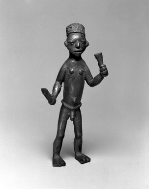 Bwayen (We, flourished 1920s-1930s). Male Nude Holding Knife and Horn, early 20th century. Copper alloy, 7 1/4 x 3 3/4 x 3in. (18.4 x 9.5 x 7.6cm). Brooklyn Museum, Museum Expedition 1922, Robert B. Woodward Memorial Fund, 22.212. Creative Commons-BY