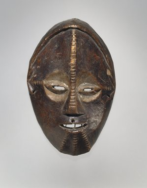 Ngbandi. Mask, 19th century. Wood, pigment, 10 1/2 x 6 5/8 x 2 3/4 in. (26.7 x 16.8 x 7 cm). Brooklyn Museum, Museum Expedition 1922, Robert B. Woodward Memorial Fund, 22.226. Creative Commons-BY