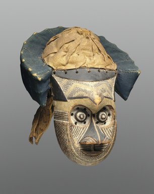 or Ngeende. Mask (Pwoom Itok), late 19th century. Wood, shell, cloth, raffia, pigment, 15 3/8 x 11 1/4 x 11 3/4 in. (39.1 x 28.6 x 29.8 cm). Brooklyn Museum, Museum Expedition 1922, Robert B. Woodward Memorial Fund, 22.230. Creative Commons-BY