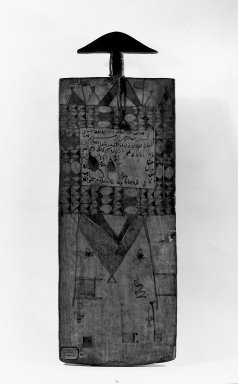 Qur'anic Writing Board, late 19th or early 20th century. Wood, ink, string, 31 7/8 x 11 x 1 in. (81 x 27.9 x 2.5 cm). Brooklyn Museum, Museum Expedition 1922, Robert B. Woodward Memorial Fund, 22.231. Creative Commons-BY