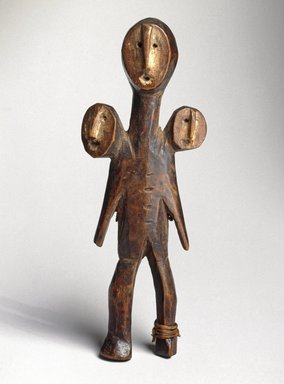 Lega. Three-Headed Figure (Sakimatwemtwe), 19th century. Wood, fiber, kaolin, 5 1/2 x 2 x 1 1/8 in. (14 x 5.1 x 2.9 cm). Brooklyn Museum, Museum Expedition 1922, Robert B. Woodward Memorial Fund, 22.486. Creative Commons-BY