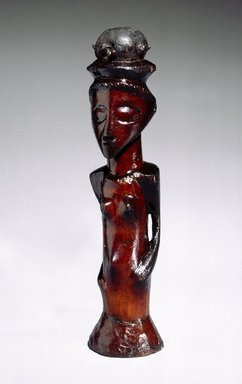 Kasongo. Female Figure with Medicinal Charge (Musinju), 19th century. Wood, metal, resin, 8 1/2 x 2 1/2 x 2 in. (21.6 x 6.4 x 5.1 cm). Brooklyn Museum, Museum Expedition 1922, Robert B. Woodward Memorial Fund, 22.817. Creative Commons-BY