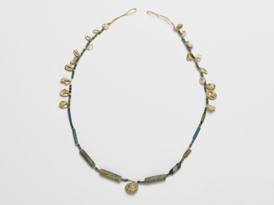 Necklace, ca. 2008-1630 B.C.E. Faience, shell, 1/2 x 18 11/16 in. length (1.2 x 47.5 cm). Brooklyn Museum, Gift of the Egypt Exploration Society, 26.167. Creative Commons-BY