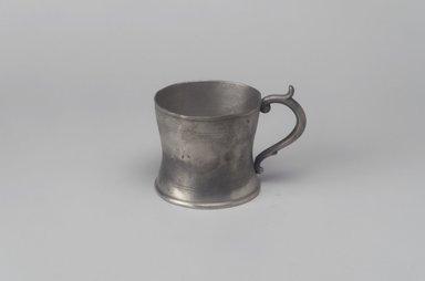 William Calder (American, 1817-1856). Cup with Handle, 1817-1856. Pewter, 2 7/8 x 3 7/8 x 2 7/8 in. (7.3 x 9.8 x 7.3 cm). Brooklyn Museum, Gift of Mrs. Samuel Doughty, 27.463. Creative Commons-BY