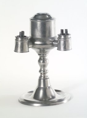 Yale and Curtis. Lamp, 1858-1867. Pewter, Overall: 8 1/4 x 5 1/4 x 5 in. (21 x 13.3 x 12.7 cm). Brooklyn Museum, Gift of Mrs. Samuel Doughty, 27.527. Creative Commons-BY