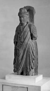 Buddhist. Medium Sized Standing Figure of a Bodhisattva, late 2nd to 3rd century C.E. Sculpture, grey schist, 16 15/16 x 6 5/16 in. (43 x 16 cm). Brooklyn Museum, Gift of Frederic B. Pratt, 27.66. Creative Commons-BY