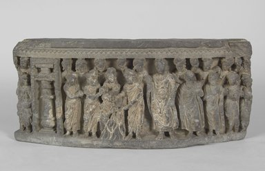 Relief of Shakyamuni and Jivaka Taking the Infant Jyotishka from the Pyre, late 2nd to 3rd century C.E. Sculpture, 7 7/8 x 3 x 17 11/16 in. (20 x 7.6 x 45 cm). Brooklyn Museum, Gift of Frederic B. Pratt, 27.68. Creative Commons-BY