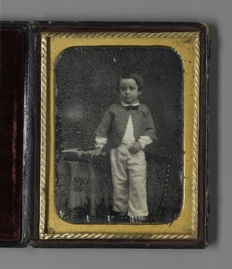 [Untitled] (Portrait of Standing Boy), n.d. Daguerreotype, Image (sight): 3 5/8 x 2 5/8 in. (9.2 x 6.7 cm). Brooklyn Museum, Gift of Minnie Pratt Smith, 27.780
