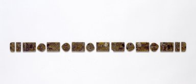Set of 16 Belt Ornaments (Ttidon), 19th century. Composite stone or horn, large rectangular pieces: 1 9/16 x 2 5/16 x 3/16 in. (4 x 5.8 x 0.5 cm). Brooklyn Museum, Brooklyn Museum Collection, 27.977.16a-p. Creative Commons-BY
