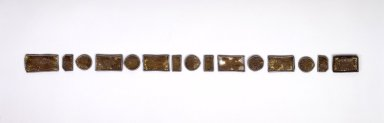 Set of 15 Belt Ornaments (Ttidon), 19th century. Plastic, metal, wood, gilded paper, large rectangular pieces: 1 9/16 x 3 1/16 x 3/16 in. (4 x 7.8 x 0.5 cm). Brooklyn Museum, Brooklyn Museum Collection, 27.977.17a-o. Creative Commons-BY