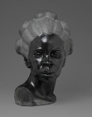 Malvina Hoffman (American, 1885-1966). Martinique Woman, 1928. Black metamorphic stone, 22 x 14 1/4 x 15 1/4 in., 158 lb. (55.9 x 36.2 x 38.7 cm, 71.67kg). Brooklyn Museum, Dick S. Ramsay Fund, 28.384. © Estate of Malvina Hoffman