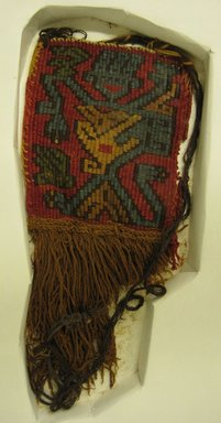 Nasca-Wari. Textile Fragment, Unascertainable or Mantle, Corner Tassel, Fragment, 200-1000 C.E. Cotton, camelid fiber, 9 13/16 x 4 5/16in. (25 x 11cm). Brooklyn Museum, Gift of George D. Pratt, 30.1206. Creative Commons-BY