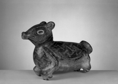 Peccary Effigy Vessel, 800-1200. Ceramic, pigment, 7 1/2 x 4 1/4 x 11 in. (19.1 x 10.8 x 27.9 cm). Brooklyn Museum, Gift of Mrs. Minor C. Keith in memory of her husband, 31.1685. Creative Commons-BY