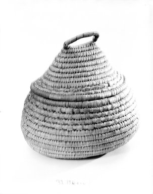 Oval and Cone Shaped Basket with Cover, early 20th century. Fiber, (22.2 x 17.0 x 21.5 cm). Brooklyn Museum, Gift of Theodora Wilbour, 32.1761a-b. Creative Commons-BY