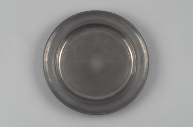 Shelton & Feltman (American, active 1847). Dish or Paten, ca. 1847. Pewter, 1 x 10 1/4 x 10 1/4 in. (2.5 x 26 x 26 cm). Brooklyn Museum, Gift of Theodora Wilbour, 32.2089. Creative Commons-BY