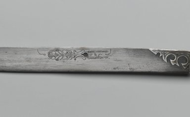 Dagger and Sheath, 1827. Iron alloy (steel) and copper alloy with gilding; sheath: copper alloy, chased and repoussé decoration, and wood lining , Length of Knife: 16 in. (40.6 cm). Brooklyn Museum, Gift of the executors of the Estate of Colonel Michael Friedsam, 32.769a-b. Creative Commons-BY
