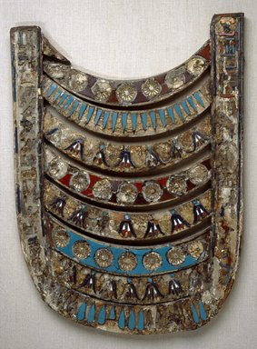 Votive Pectoral of Ptolemy V, 205-180 B.C.E. Wood, plaster, and glass, 19 5/8 x 14 1/2 in. (49.8 x 36.9 cm). Brooklyn Museum, Charles Edwin Wilbour Fund, 33.383. Creative Commons-BY
