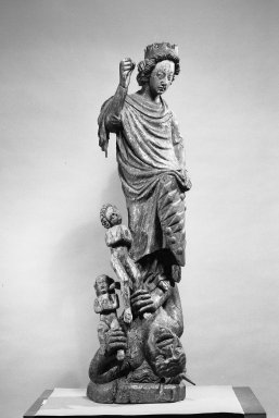 St. Michael Slaying the Devil who Holds Two Children in his Grasp, 13th century. Wood, polychrome, Height: 49 in. (124.5 cm). Brooklyn Museum, Charles Stewart Smith Memorial Fund, 33.394. Creative Commons-BY