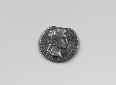 Greek. Denarius of Augustus, 27 B.C.E.E. - 14 C.E. Silver, 11/16 x 3/4 x 1/16 in. (1.7 x 1.9 x 0.2  cm). Brooklyn Museum, Frederick Loeser Fund, 33.403.17. Creative Commons-BY