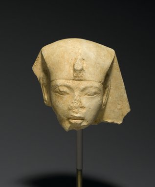 Head from a Shabty of King Akhenaten, ca. 1352-1336 B.C.E. Limestone, 2 13/16 x 2 3/4 x 2 3/4 in. (7.2 x 7 x 7 cm). Brooklyn Museum, Charles Edwin Wilbour Fund, 33.52. Creative Commons-BY