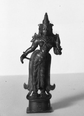 Brahmanical. Figure of Laksmi, 18-19th Century. Brass, 8 1/16 x 3 1/8 in. (20.5 x 8 cm). Brooklyn Museum, Brooklyn Museum Collection, 34.143. Creative Commons-BY