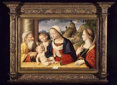 Marco Palmezzano (Italian, School of Romagnola, circa 1459/63 - 1539). Holy Family with Saints John the Baptist and Catherine of Alexandria, 1521. Tempera and oil on poplar panel, 23 3/4 x 36 1/4 in. (60.3 x 92.1 cm). Brooklyn Museum, Gift of the executors of the Estate of Colonel Michael Friedsam, 34.499