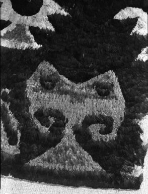 Chimú. Fragment of Tunic or Tabard, 1400-1700. Cotton, feather, 12 5/8 x 15 3/8 in. (32 x 39 cm). Brooklyn Museum, George C. Brackett Fund, 34.577. Creative Commons-BY