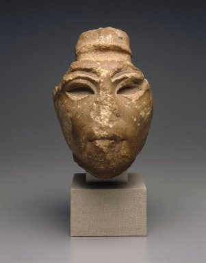 Head from a Composite Statue, ca. 1352-1334 B.C.E. Yellow quartzite, traces red paint on lips, 7 1/16 x 5 11/16 in. (18 x 14.5 cm). Brooklyn Museum, Gift of the Egypt Exploration Society, 34.6042. Creative Commons-BY
