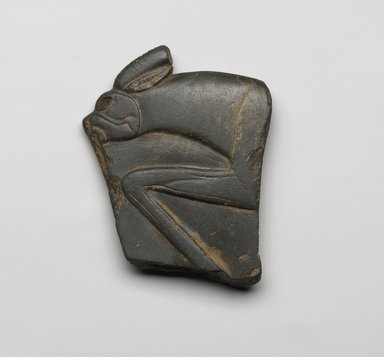 Fragment of Palette, ca. 3300-3100 B.C.E. Schist, 4 1/16 x 3 1/4 x 1/2 in. (10.3 x 8.3 x 1.3 cm). Brooklyn Museum, Charles Edwin Wilbour Fund, 35.1272. Creative Commons-BY