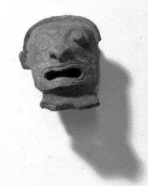 Head, Blackened. Clay Brooklyn Museum, Ella C. Woodward Memorial Fund, 35.1706. Creative Commons-BY