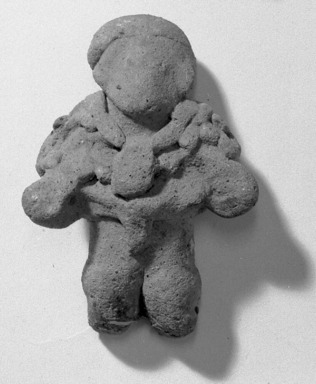 Figure Wearing Necklace