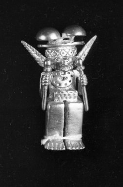 Gold Idol Seated Holding a Sceptre in Each Hand with Double Mushroom Headdress. Gold, 2 5/8in. (6.7cm). Brooklyn Museum, Alfred W. Jenkins Fund, 35.195. Creative Commons-BY