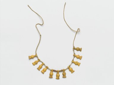 Fragmentary Necklace, ca. 1539-1292 B.C.E. Faience, Average dimension of pendant: 7/16 x 1/8  (1.1 x 0.3 cm); Length between end amulets: 3 3/8 in. (8.6 cm). Brooklyn Museum, Gift of the Egypt Exploration Society, 35.2023. Creative Commons-BY