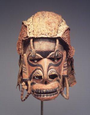 Mask (Tatanua), 19th century. Wood, bark, fiber, Turbo petholatus opercula, pigment, 12 1/4 x 8 x 10 1/2 in. (31.1 x 20.3 x 26.7 cm). Brooklyn Museum, Gift of Russell Sturgis, 35.2212. Creative Commons-BY