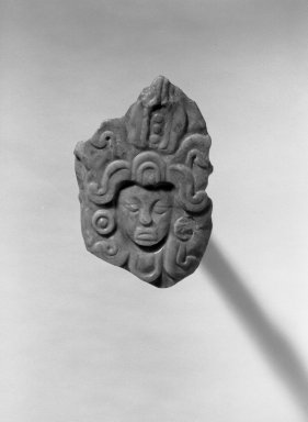 Pendant in Form of Human Head. Jadeite, 2 1/4 x 3/8 x 3 1/2 in. (5.7 x 1 x 8.9 cm). Brooklyn Museum, Frank L. Babbott Fund, 36.268. Creative Commons-BY