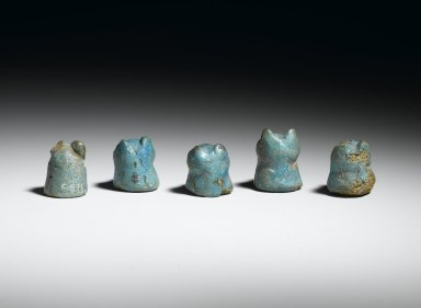 Lion-Headed Gaming Piece, 1 of 5, ca. 1938-1759 B.C.E. Faience, 7/8 x 5/8 in. (2.2 x 1.6 cm). Brooklyn Museum, Charles Edwin Wilbour Fund, 36.3.1. Creative Commons-BY