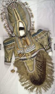 Inupiaq Eskimo (Native American). Woman's Beaded and Fringed Wedding Dress, 1900-1930. Caribou hide, caribou teeth, wood, beads, 63 x 29 in. (160 x 73.7 cm). Brooklyn Museum, Frank L. Babbott Fund, 36.31. Creative Commons-BY