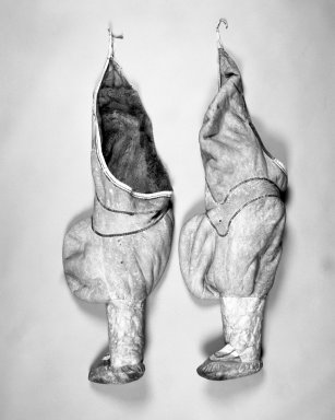 Inupiaq Eskimo (Native American). Woman's Pair of Leggings/Boots, 1900-1930. Caribou skin, each: 41 x 14 in. (104.1 x 35.6 cm). Brooklyn Museum, Frank L. Babbott Fund, 36.33a-b. Creative Commons-BY