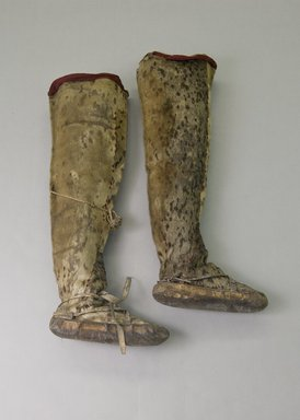 Inupiaq Eskimo (Native American). Man's Pair of Thigh-high Boots with red fabric decoration, 1900-1930. Sealskin, wool, cloth, yarn, each ca. 29 x 11 1/2 x 5 3/4 in. or (80.5 x 28.5 cm). Brooklyn Museum, Frank L. Babbott Fund, 36.37a-b. Creative Commons-BY