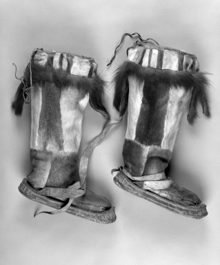 Inupiaq Eskimo (Native American). Pair of Boots with tassels at the front and back and drawstring tops, 1900-1930. Caribou hide, Canadian Lynx fur, a: 15 1/2 x 10 1/4 x 3 1/2 in. or (39.0 x 28.0 cm). Brooklyn Museum, Frank L. Babbott Fund, 36.38a-b. Creative Commons-BY