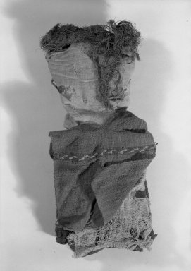 Chancay. Figural Sculpture, 1000-1532. Cotton, camelid fiber, plant seed, furcraea(?), 13 3/8 x 5 1/2 x 2 3/4 in. (34 x 14 x 7 cm). Brooklyn Museum, Gift of Mrs. Eugene Schaefer, 36.406. Creative Commons-BY