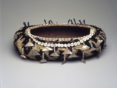 Pomo (Native American). Oblong-shaped Basket, late 19th or early 20th century. Fiber, beads, feathers, mother of pearl, 2 15/16 x 12 x 7 in. (7.5 x 30.5 x 17.8 cm). Brooklyn Museum, Gift of Frederic B. Pratt, 36.523. Creative Commons-BY