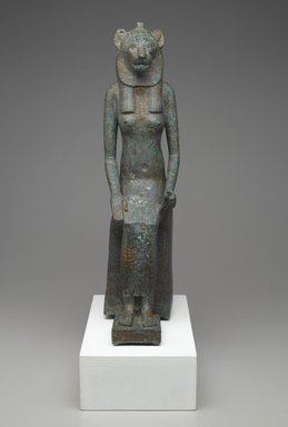 Seated Wadjet, 664 B.C.E. – 332 B.C.E. Bronze, animal remains, 20 1/2 x 4 7/8 x 9 1/2 in. (52.1 x 12.4 x 24.1 cm). Brooklyn Museum, Charles Edwin Wilbour Fund, 36.622. Creative Commons-BY