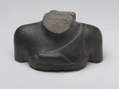 Fragment of the Breast and Shoulder of a Man, 305-30 B.C. Basalt, 3 1/8 x 6 15/16 x 3 7/8 in. (8 x 17.6 x 9.9 cm). Brooklyn Museum, Gift of Louis Herse, 36.737. Creative Commons-BY