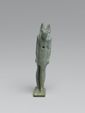 Statue of Anubis Standing, 664-332 B.C.E. Faience, glazed, 2 1/16 x 3/8 x 11/16 in. (5.3 x 0.9 x 1.8 cm). Brooklyn Museum, Charles Edwin Wilbour Fund, 37.1017E. Creative Commons-BY